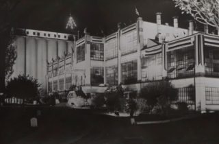 Shredded Wheat 1937, decorated for the Coronation, taken at night,  Library photo collection, Hertfordshire Archives and Local Studies