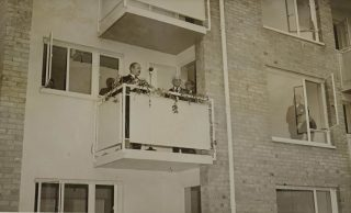 Photograph of people on a balcony at the opening of Pondcroft flats in 1952 | Herts Advertiser (Hertfordshire Archives & Local Studies ref CNT/WH/1/1/16)