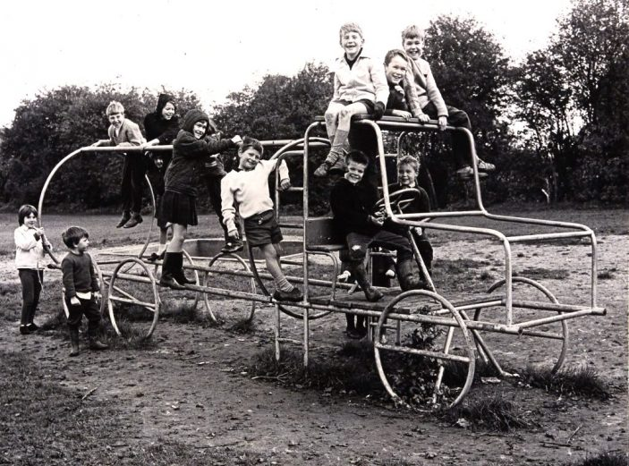 Shoplands playground, behind 185 Knightsfield, Welwyn Garden City. Bus shaped climbing frame, taken in 1966.  | Hertfordshire Archives and Local Studies, reference CNT_WH_11_1_2_10_2. Copyright Ken Wright