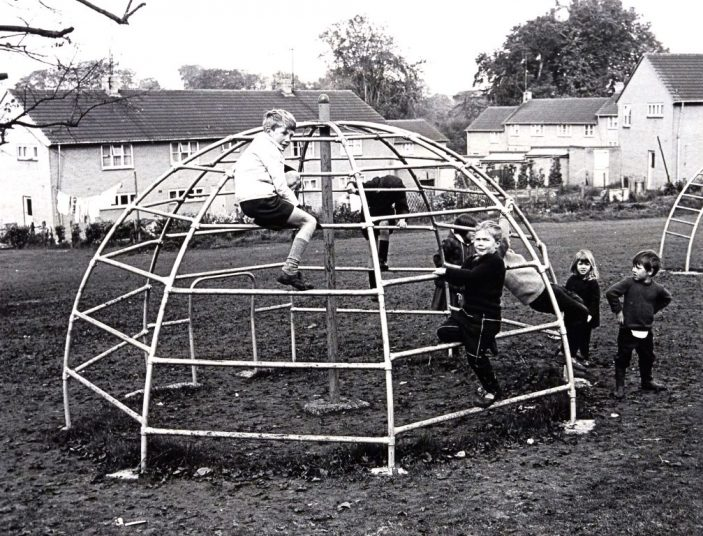 Shoplands playground, behind 185 Knightsfield, Welwyn Garden City. The dome shaped climbing frame. Houses in background are in Summer Dale. Taken in 1966.  | Hertfordshire Archives and Local Studies, reference CNT_WH_11_1_2_10_4. Copyright Ken Wright