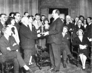 Lord Walden presenting the Howard de Walden Cup to Ernest Selley. CB Purdom is behind Selley.