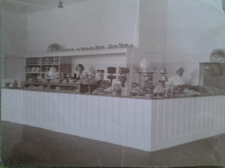 Confectionary Counter with baker Mr Curry and assistant | Welwyn Garden City Library