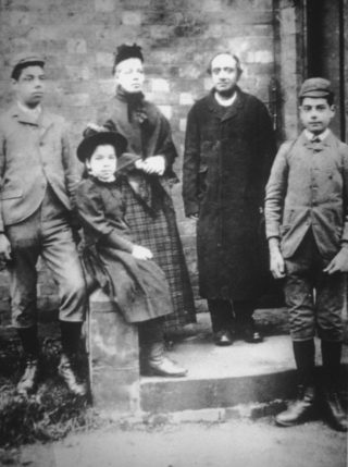 Edalji family, 1892.  George is on the left and Maud is sitting next to him.