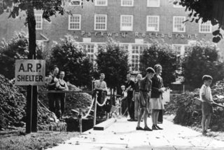 Air raid precautions in Welwyn Garden City, digging shelters outside the Parkway Restaurant 1939 | Hertfordshire Archives and Local Studies