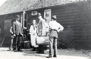 Actors rehearse for an early production at Brickwall Farm. WC Horn on left. C B Purdom with case. Could it be young Bill on right? | Welwyn Garden City Library