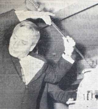 Dick Emery cutting the giant cake with a sword | Hertfordshire Mercury 25 September 1964 page 11