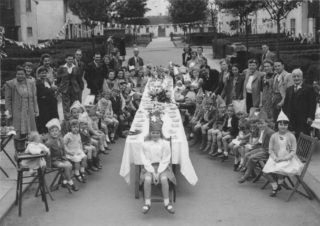 Ethelred Close with Nursery in background. Probably a children's VE party 1945.
