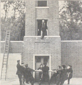 A Fireman makes a stately descent into the sheet from the third floor of the tower | Welwyn Times, photo by Lisa