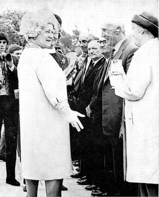 Molly Jennings, WGC's first resident, is presented with a goblet by the Queen Mother, during the town's Golden Jubilee Celebrations in 1970 | Welwyn Garden City Library