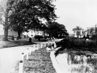 Handside Pond c1923. It was filled in around 1927, considered a health hazard.   Hertfordshire Archives and Local Studies