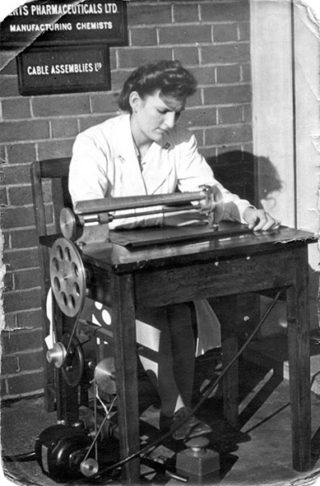 A 16 year old Kit operating a new heat sealing machine | Welwyn Garden City Heritage Trust archive