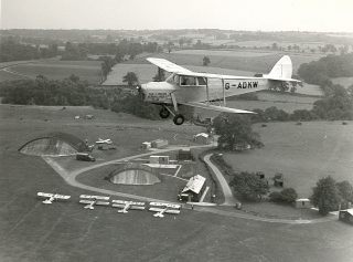 Hornet Moth flying over the North Side Training area - 1947   BAE SYSTEMS