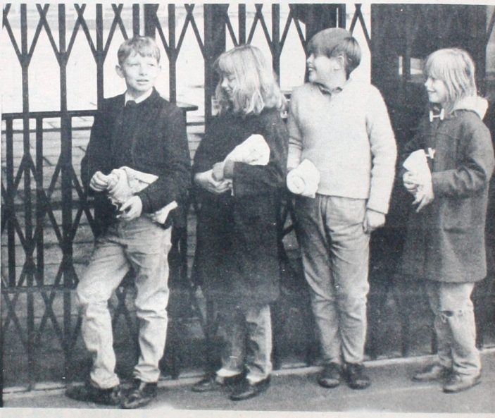 6.55am The first arrivals at the pool. Left to right are Robert Catt (13) of Peartree Lane, Maureen (12), Trevor (13) and Elaine Gibson (10) of Holwell Road | Denis Williams, Welwyn Times and Hatfield Herald 23 April 1965, page 18