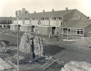 Panshanger E1 & A1 housing. Dec 1965. In the background you can see the Smith Kline Tower on Mudells | Hertfordshire Archives and Local Studies