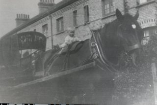 Bill's son on Prince the coal horse, outside The Row, Hatfield Hyde. | Welwyn Garden City Library