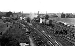 The clearing up operation. The station building can be seen on the right, and the huge crane used in the middle. | Hertfordshire Archives and Local Studies
