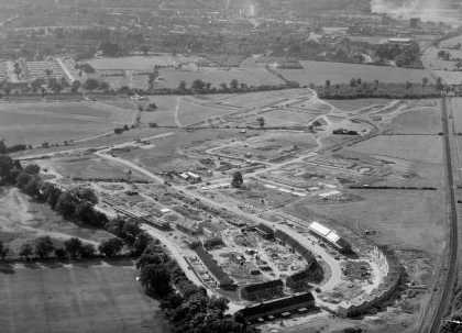 Ganett area, Summer 1952. The Hertford/Dunstable rail line can clearly be seen and there is engine smoke in the distance. Shredded Wheat can be seen, as well as the prefabs of the Wellcroft area. The top end of Great Ganett that Mrs Lloyd describes is still a year away from being finished. | Welwyn Garden City Library