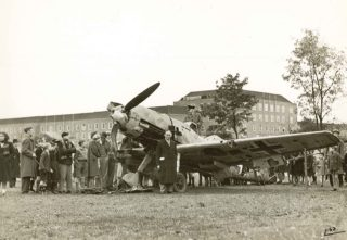 Messerschmit Me109 on the Campus with Welwyn Department Store (now John Lewis) behind. | Studio Lisa/Mill Green Museum