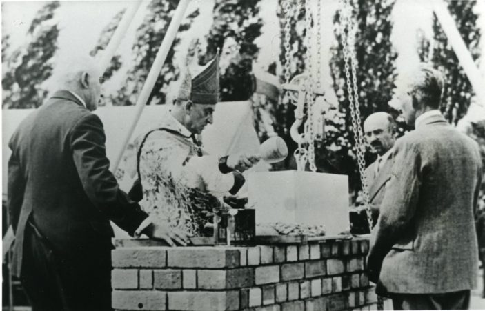 Bishop Furze laying the foundation stone St Francis church, Welwyn Garden City. c1934 | Hertfordshire Archives and Local Studies