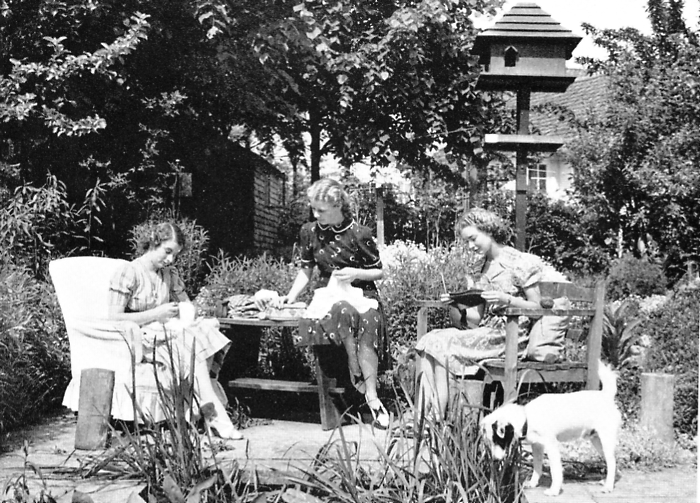 An informal photo taken in the garden of 14 Parkway, featuring the Sheridan children, one of which is probably Dinah | Welwyn Garden City Library