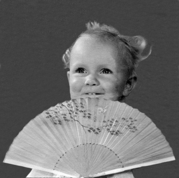 modelling with a fan.