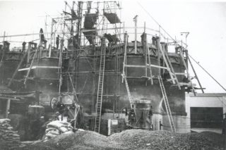 House height silos with wooden scaffolding | Welwyn Garden City Library